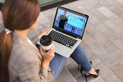 Student completing her life coach certification training online